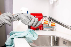cleaner removing gloves
